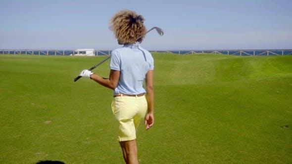 Thumbnail for Female Golfer Walking Down a Fairway