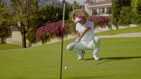 Thumbnail for Young Female Golfer Lining Up a Putt