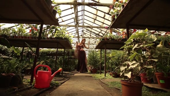 Thumbnail for Redhead Girl In The Greenhouse