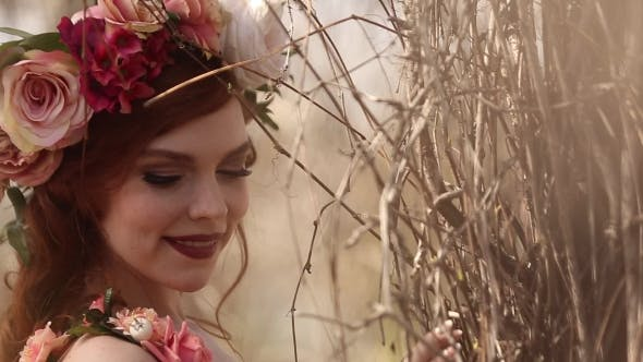 Thumbnail for Beautiful Red-haired Woman Standing In a Flower Wreath On His Head