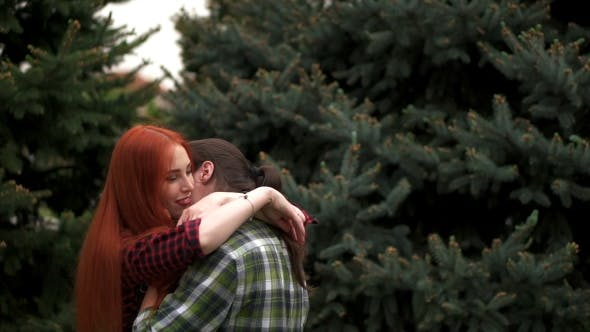 Thumbnail for Happy Couple Hugging In Summer Park Among Spruces