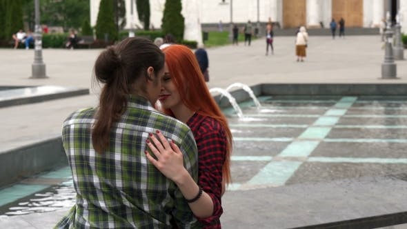 Thumbnail for Young Couple Hugging By The Fountain
