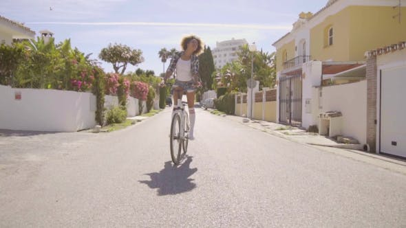 Thumbnail for Girl Riding With Feet Out On A Bicycle