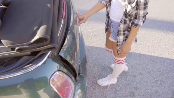 Thumbnail for Girl Taking Out Her Roller Skates From Trunk
