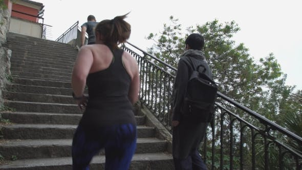 Thumbnail for Runners Run Up The Stairs By Walking Women With Backpack.