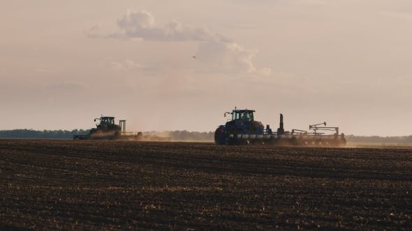 Thumbnail for Two Tractor Ride Through The Field. Lead Planting