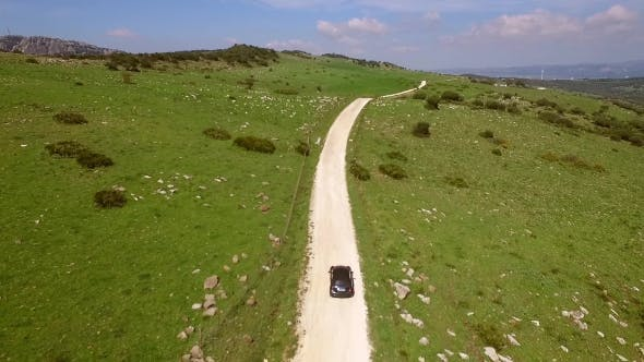 Thumbnail for Aerial View Of Driving Car On Hilly Terrain