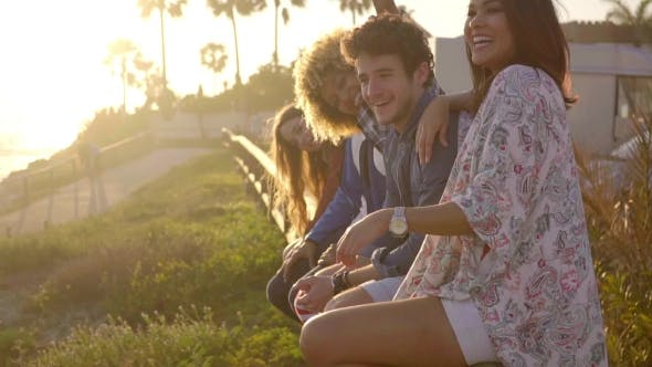 Thumbnail for Young People Sitting On Wooden Fence.