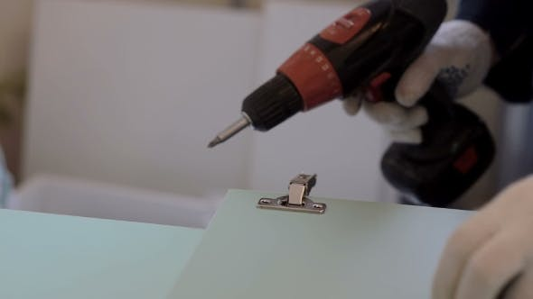 Thumbnail for Man Assembles Furniture Using a Power Screwdriver