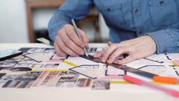Thumbnail for Stylish Architect Working On Blueprint