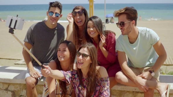 Thumbnail for Group Of Happy Young Friends Posing For a Selfie