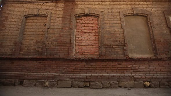 Thumbnail for Girl In a Leather Jacket And Boots Posing In a Red Brick Wall