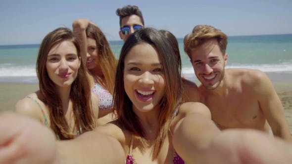 Thumbnail for Group Of Friends Taking Selfie On Sunny Beach