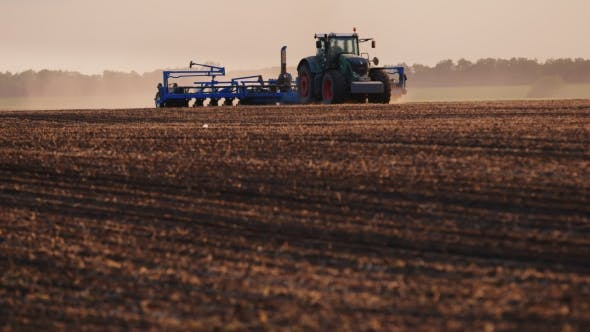 Thumbnail for Tractor With Drill Goes Through The Field, Carried Out In Spring Seeding