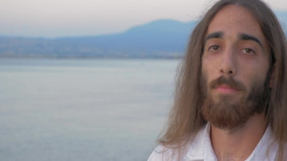 Thumbnail for Long-haired Man With Beard Looking To The Camera