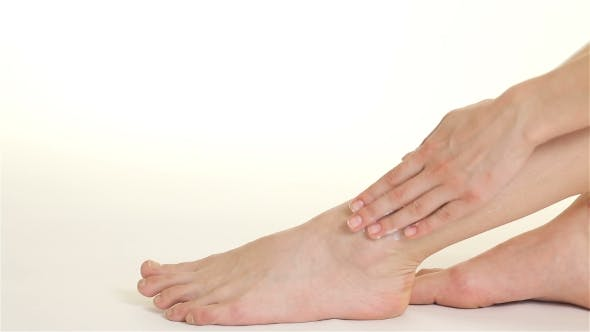 Thumbnail for Woman Creams Her From Ankle Till Knee