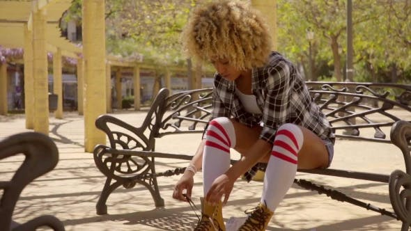 Thumbnail for Woman Prepares For Roller Skating Outdoors