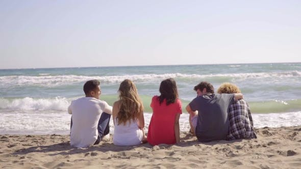 Thumbnail for Young People Sitting On The Beach.