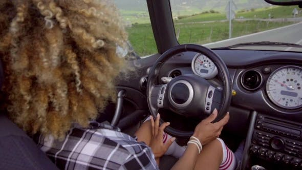 Thumbnail for African American Woman Driving A Cabriolet.