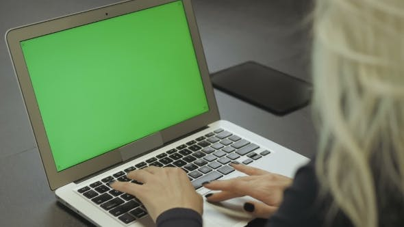 Thumbnail for Female Hands Typing on the Laptop Keyboard. Laptop With Green Screen
