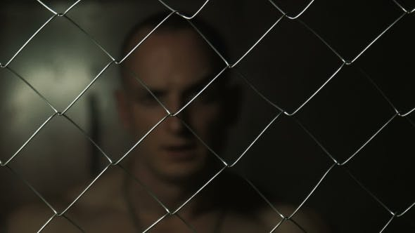 Thumbnail for Topless Prisoner Looking Through The Barbed Wire