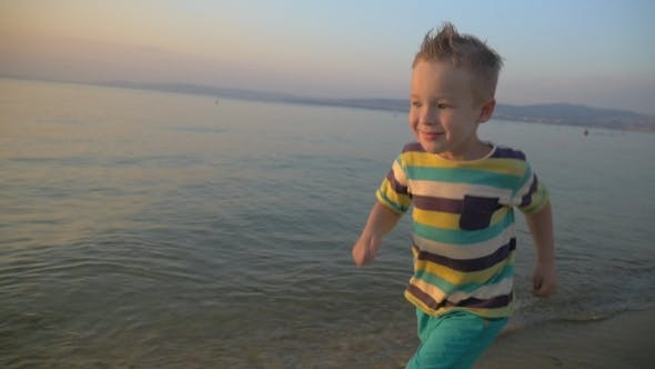 Thumbnail for Happy Boy Running On The Sea Coast At Sunset
