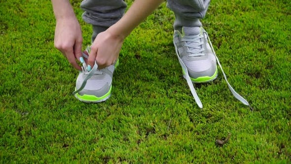 Thumbnail for Girl Stopped Running To Tie The Laces On Running Shoes. Fitness Girl Training Outdoors