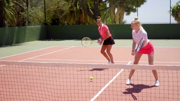 Thumbnail for Two Pretty Women Playing a Game Of Tennis Doubles
