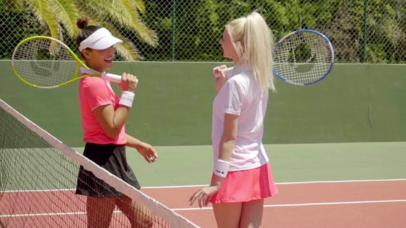 Thumbnail for Pair Of Friends Talking On Tennis Court