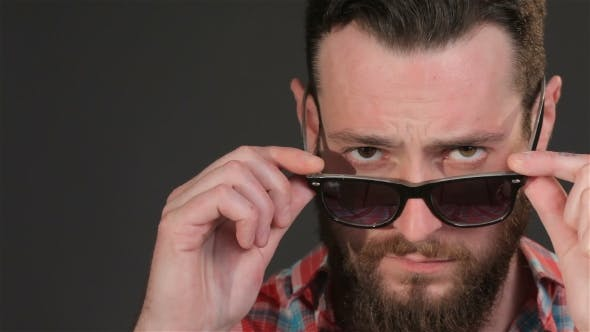 Thumbnail for Young Hipster Corrects His Sun Glasses