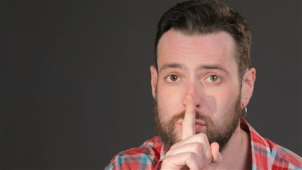 Thumbnail for Young Hipster Makes Silence Gesture