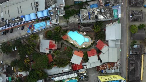 Aerial top down view of a scity with many swimming pools