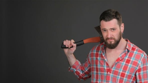Thumbnail for Bearded Hipster Puts An Ax On His Shoulder