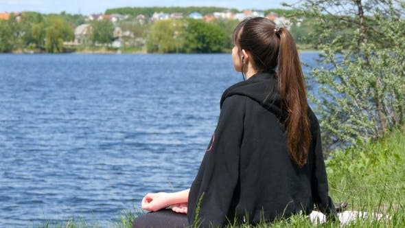 Cover Image for Young Woman Removing His Jacket Enjoying Sun and Warmth