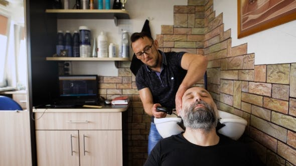 Thumbnail for Eccentric Stylist Washes Head Respectable Men. Businessman Visits To His Barber, That Would Shear
