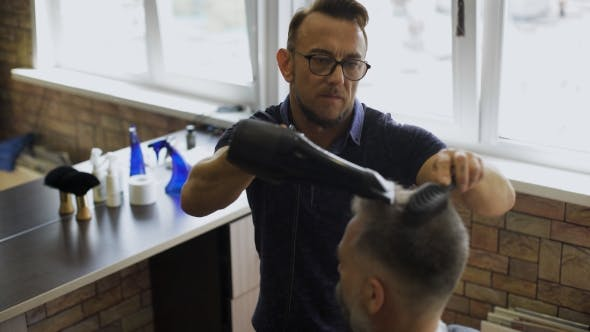 Thumbnail for Hairdresser Fixes Hairstyle With a Hair Dryer.