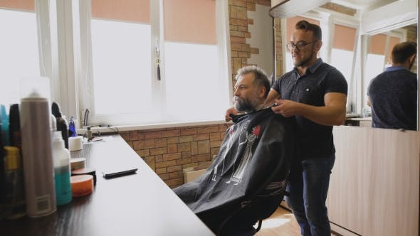 Barber Prepares Highly Respect The Client To The Haircut.