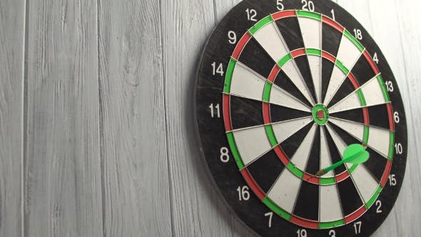 Thumbnail for Playing Darts On White Wood Wall
