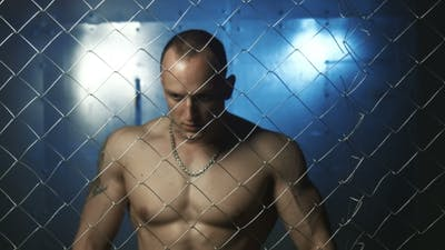 Young Muscular Man Beyond Wire In Jail