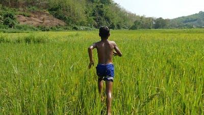 Poverty Boy Running In Grass