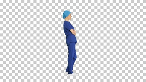 Female nurse or surgeon wearing blue suit, Alpha Channel