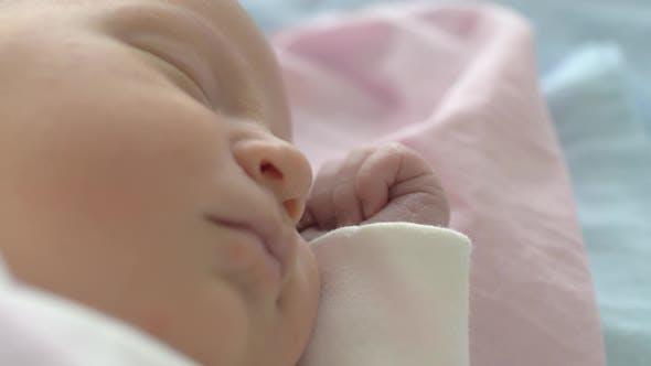 A Closeup of a Sleeping Baby Cute Face