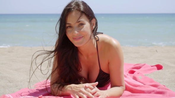 Thumbnail for Attractive Young Woman Enjoying a Summer Vacation