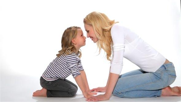 Thumbnail for Kid And Mother Do Eskimo Kiss