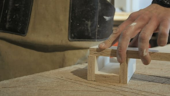 Thumbnail for Worker Using Staple Gun To Fix Wood Parts