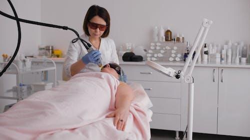 Getting a Laser Skin Treatment In Healthy Beauty Spa Salon