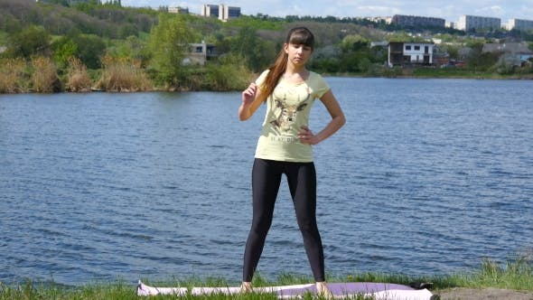 Thumbnail for Fitness Girl Exercising Outdoors Beside The River Doing Squat Exercise