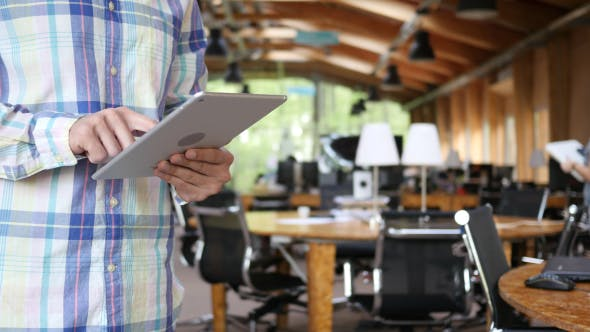 Thumbnail for Young Man Using Tablet at Workplace