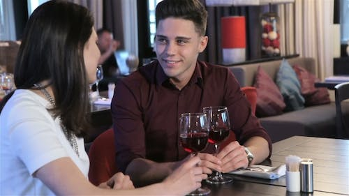 Young Couple Have a Date At The Restaurant