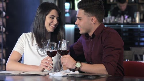 Couple Clink Their Glasses